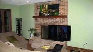 can you put a tv above a fireplace awesome can you mount tv over wood burning