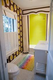 fun bathroom with osborne and little clarendon wallpapers folia wallpaper vintage penny tiles floor white single washstand with marble top neon green