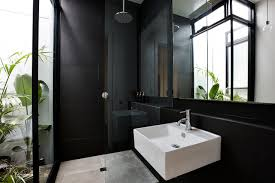 Example of a trendy black tile and ceramic tile ceramic floor bathroom  design in Melbourne with