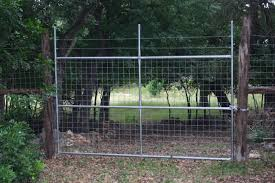 welded wire fence gate. Welded Wire Gate With Metal Post Frame And Barbed Fence S