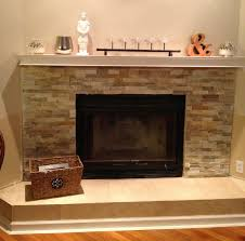 Interior. beige tile Fireplace Base Ideas and grey stone fireplace also  black metal fire box