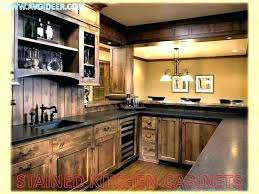 white and tan kitchen tan kitchen cabinets dark gray grey cabinet floor light colored doors white