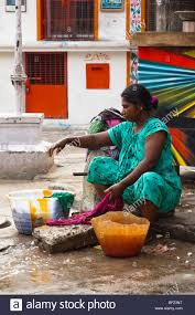 woman washing clothes by hand.  Hand An Indian Woman Hand Washing Clothes On The Street Chennai Tamil Nadu  India  Stock In Woman Washing Clothes By Hand