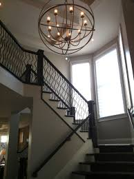 greet your guest with dazzling foyer chandeliers outstanding orb light fixture for foyer chandeliers with