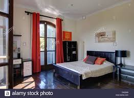 Spanish Bedroom Furniture Red Curtains On French Windows In Spanish Bedroom With Black