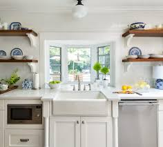 natural elements with wood shelving green accents cabinets are white dove design by maria killam
