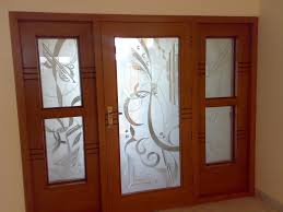 frosted glass door with curving ornaments plus brown wooden frame also frosted glass windows beside with