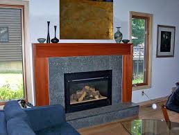 fireplace and granite the stained wood and granite tile on this surround give this gas fireplace fireplace and granite