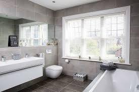 A modern grey tiled bathroom
