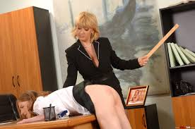 Young Lolly Cat gets a hand and ruler spanking from Madam Pichunter