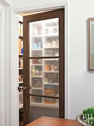 A glass-pane door adds character to a kitchen. To keep pantry contents  hidden, cover the glass squares with translucent contact paper or frosted  paint.