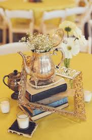 vine wedding centerpieces of frames tea pots and old books