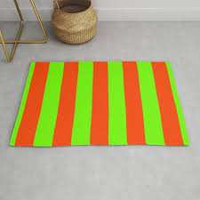 bright neon green and orange vertical cabana tent stripes rug