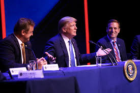 president donald trump center speaks during a roundtable discussion on tax cuts while flanked