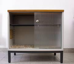 vintage metal cabinet with sliding glass doors from mauser werke waldeck 1960s 9 375 00