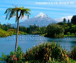 mount egmont as seen from lake mangae in spring taranaki new zealand