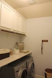 cabinets in laundry room. burrows cabinets laundry room in bone