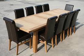 2 4 2 9m erfly extending european oak tallinn table emperor full leather roll back chairs