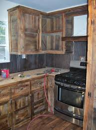 used kitchen furniture. we built these barn wood cabinets and used old tin for a back splash kitchen furniture