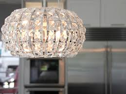 Crystal Pendant Lights Above Contemporary Kitchen Island