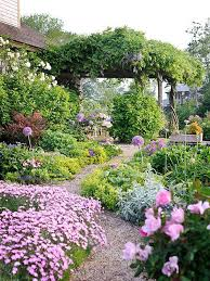lush magical flower garden with pathway