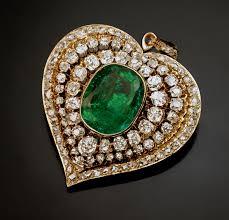 an antique victorian era emerald and diamond heart shaped pendant