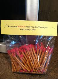matches for a fireman gift basket pretzel rods dipped in red chocolate with yellow and orange sprinkles