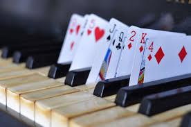 Risultati immagini per playing cards music wallpaper