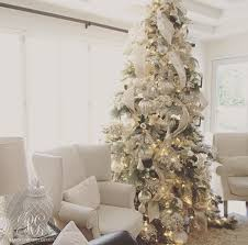 ... Elegant flocked white Christmas tree with mercury glass ornaments by  Randi Garrett Design