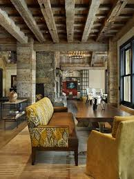 Old wood ceiling beams, stone and wooden walls, modern interior design