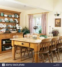 Pine Kitchen Tables And Chairs Pine Table And Chairs And Large Pine Dresser In Country Kitchen