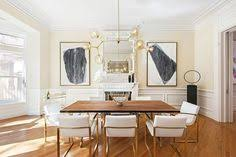 chic dining room design in neutral white beige soft yellow and gold color