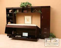 Hidden bed for the playroom ... I love that it doubles as a desk