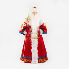 Toy under the <b>Christmas tree Santa Claus</b> in red coat boyar ...