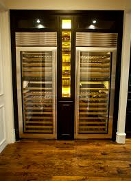 thermador wine. thermador wine columns with custom cigar humidor adorned by led lighting. e
