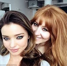 flawless miranda kerr showed off her natural beauty on wednesday as she teamed up with