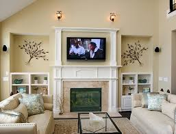 small family room wall decorations with tv above electric fireplace also using sloped ceiling design ideas
