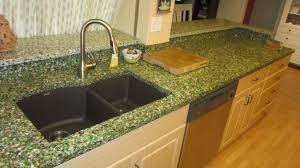 kraus sink with waterstone faucet and oak kitchen cabinets plus cozy vetrazzo for traditional kitchen design