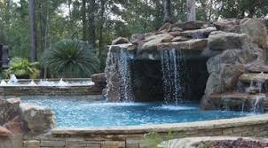 backyard pools with waterfalls and slide. Interesting Waterfalls Contact Regal Pool Design To Add Some Tropical Flair Your Backyard With  A Custom Waterfall Grotto And Pool Slide Inside Backyard Pools With Waterfalls And Slide O