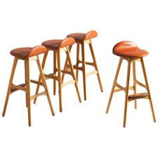 on very plete set of four solid oak barstools by erik buck these stools have been produced with the highest care which can be seen in the