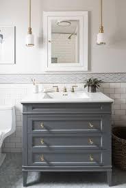 hanging pendants add depth to this bathroom sink