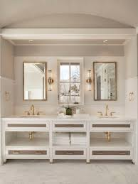Coastal marble floor bathroom photo in New York with recessed-panel cabinets