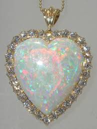 the large heart shaped australian opal possesses all three desired colors green blue and