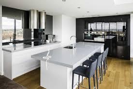 Mirror Backsplash In Kitchen Black Cabinets Gray Solid Countertop Dark Bar Stools Large Mirror
