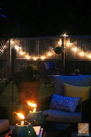 backyard string lighting ideas. simple patio decorating ideas string lights and torches create a fun magical atmosphere on backyard lighting