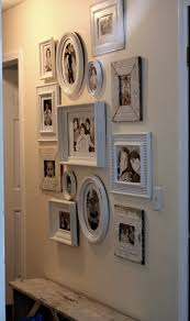 White frames wall collage black and white photos. I really want to do white  frames in the hallway this looks nice.