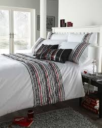 comfortable black and white striped bedding with gray carpet
