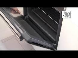 how do i clean my oven door
