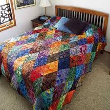 Thousand Pyramids Quilt by Shon McMain Pull batiks from your stash ... & Thousand Pyramids Quilt by Shon McMain Pull batiks from your stash to make  this dynamic quilt Adamdwight.com