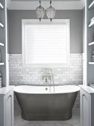 beautiful gray bathroom with gray wall color and marble tiled half wall